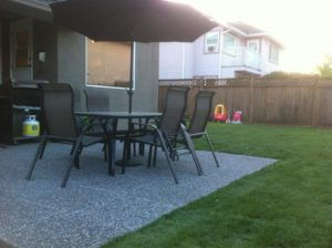 New Patio Installations surrounded by feshly cut grass