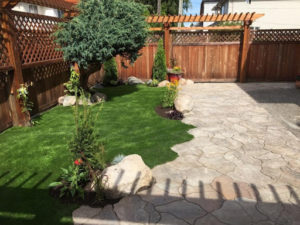 Synthetic Grass & Manufactured Flagstone Installation