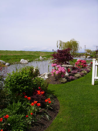 Beautiful flower beds and lawn
